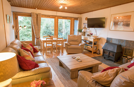 Lounge with log burner at Self Catering Chalet Salen Ardnamurchan Scotland